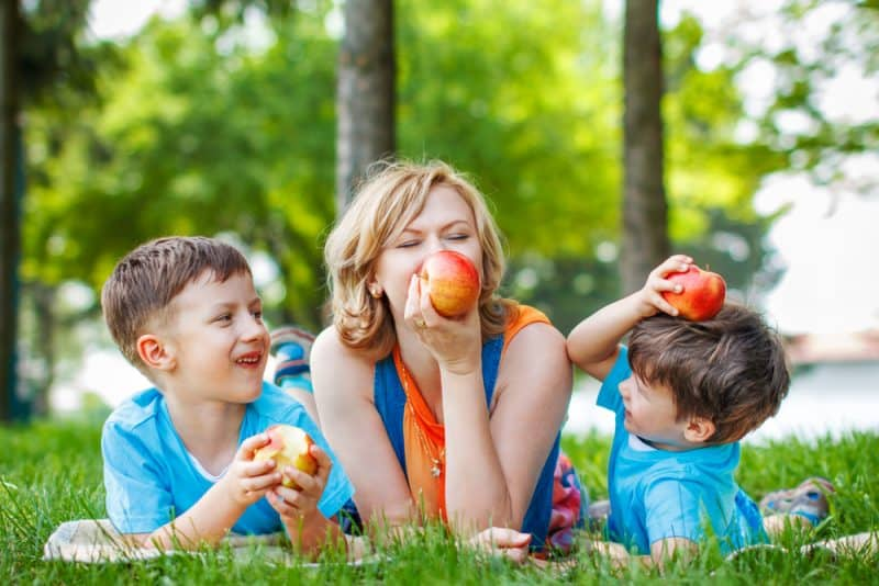 lifegiving homeschooling family eating apples on a nature walk